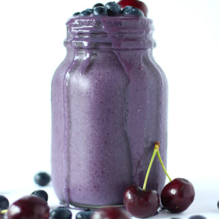 This berry packed smoothie is perfect for those early mornings and afternoon pick me ups! Filled with blueberries, cherries, oats, it's pure deliciousness in a glass!