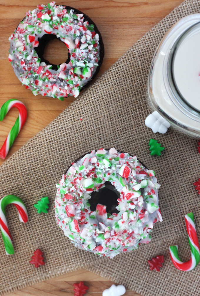 Dreamy chocolate donuts topped with a crunchy, minty candy cane icing! These are the perfect treat to leave out for Santa on Christmas Eve!